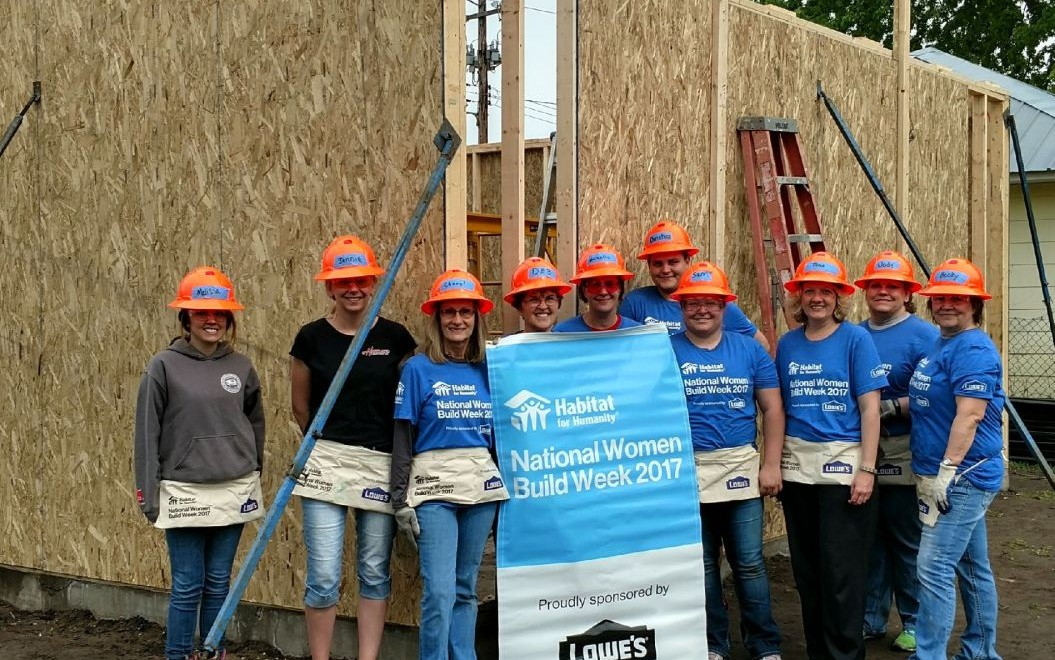 Employees helped construct a new home during National Women Build Week